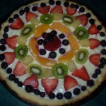 Fruit pizza pie with sugar cookie crust