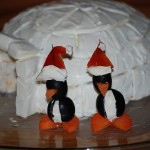 Twist old treats into new holiday fun – Olive penguins with Santa hats