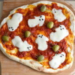 Ghouly pizza – Mozzarella ghosts and olive spiders