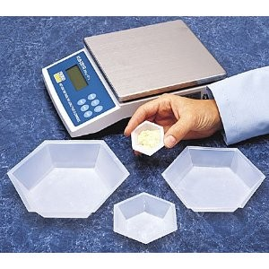 Science lab weigh boats used as hex - shaped serving bowls for Settlers of Catan gaming brunch buffet setup