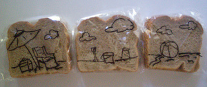 Sandwich Bag Art - A full beach scene drawn on 3 different sandwich ziplock baggies with a beach chair, ball, sand, buckets, etc, using a Sharpie for the kids lunches.